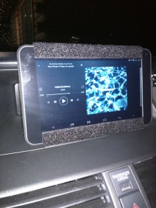 A android tablet mounted into the center dash of a Honda Accord.